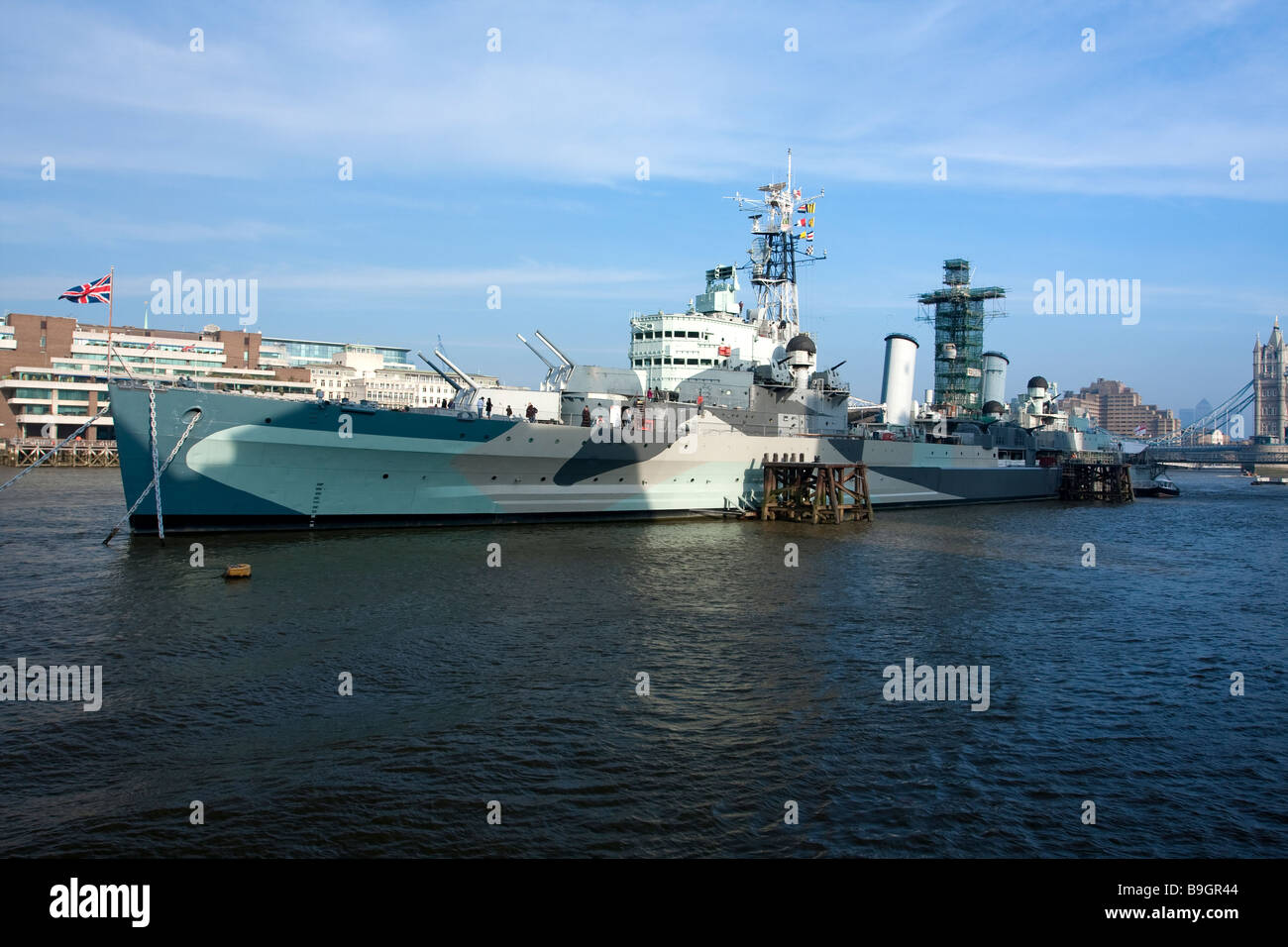 HMS Belfast on South Bank of the river Thames - Stock Image