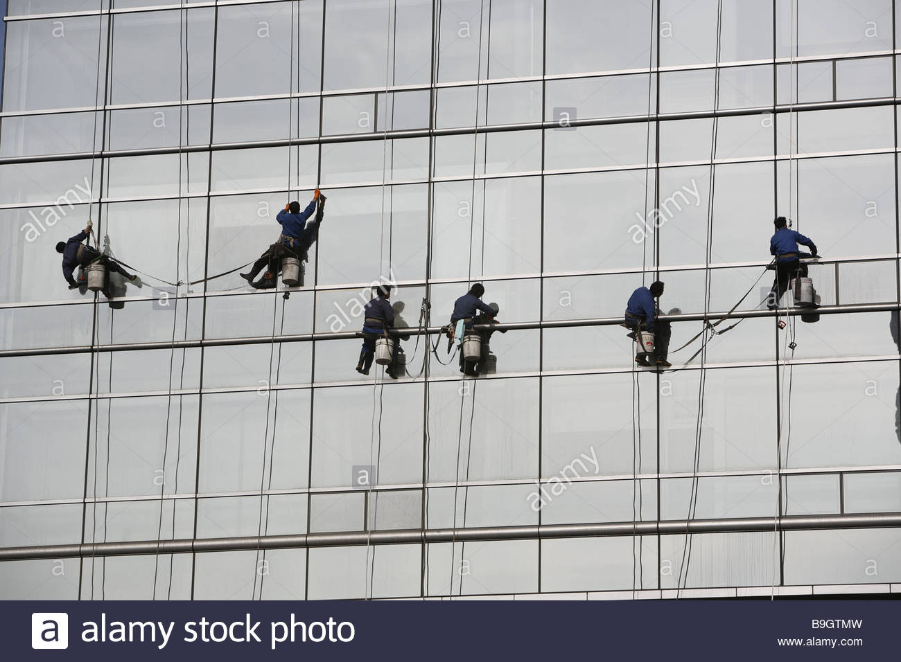 High-rise glass-facade detail window cleaner buildings office Stock ...