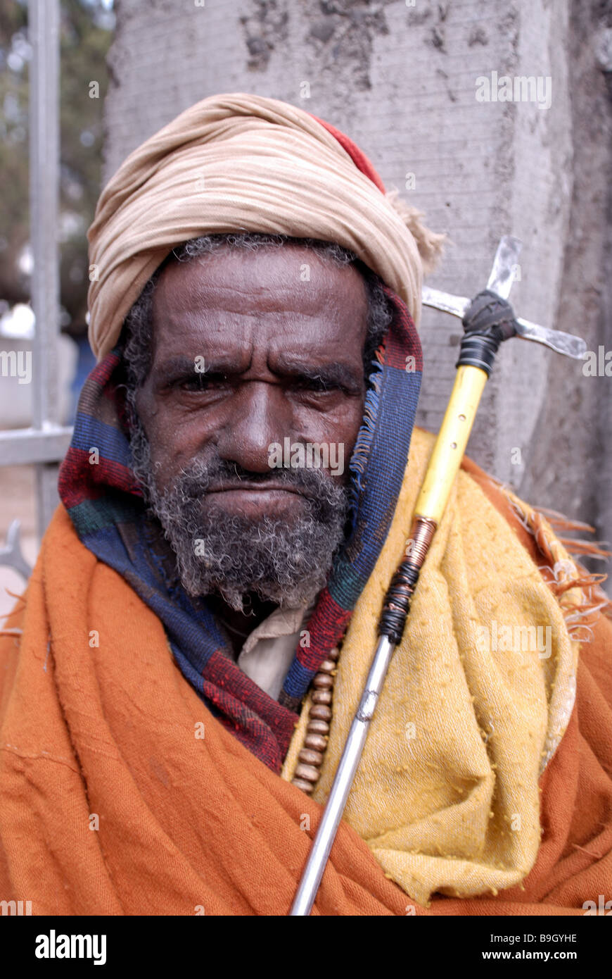 Ethiopia Lalibela pilgrims seriously portrait East-Africa people man old creditors headgear prayer-stick cross belief - Stock Image