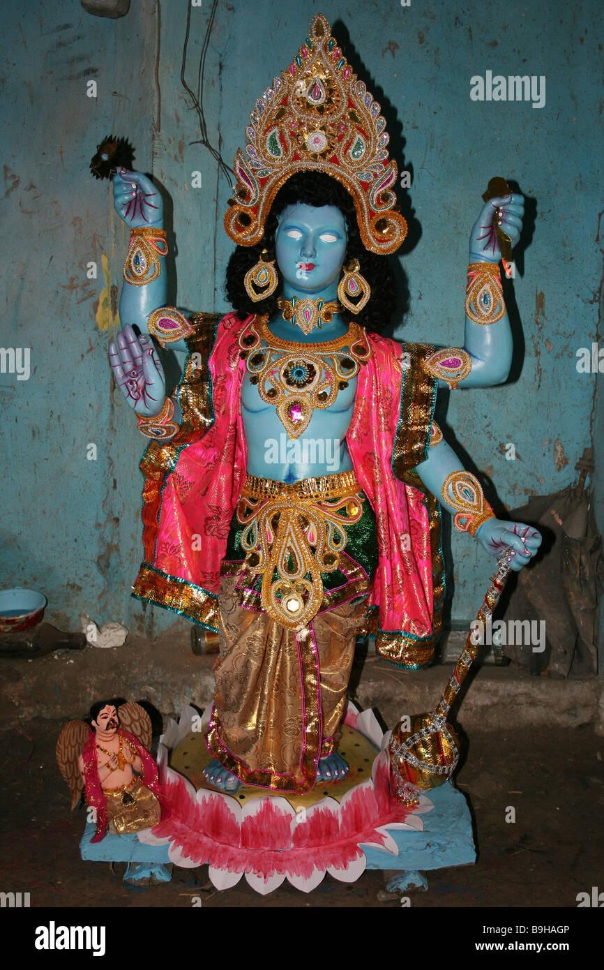 Painted Statue of Hindu God Vishnu in the Potters Market, Kumortuli, Kolkata - Stock Image