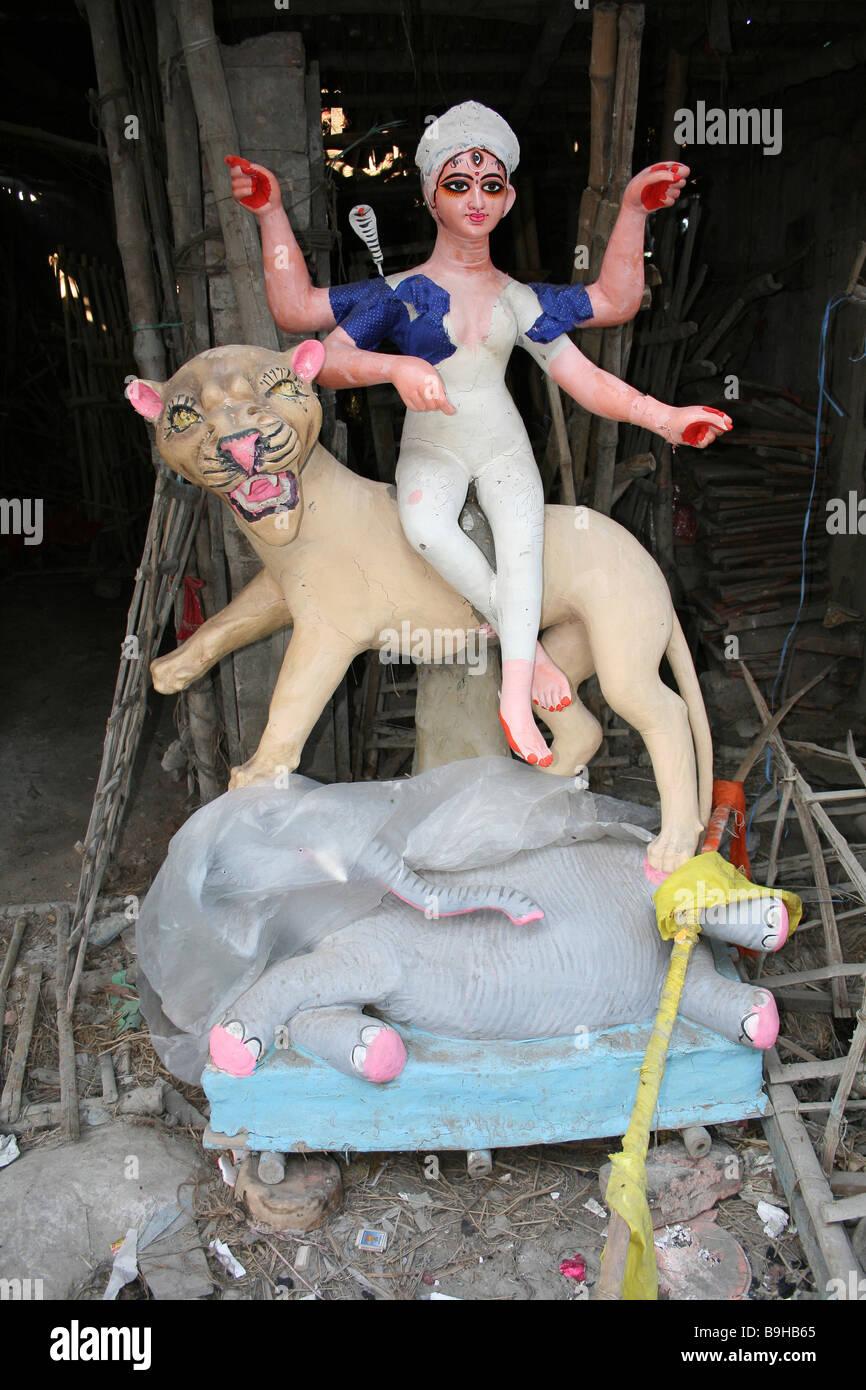 Semi-painted Statue of Durga Riding Lion, Potters Market, Kumortuli, Kolkata - Stock Image
