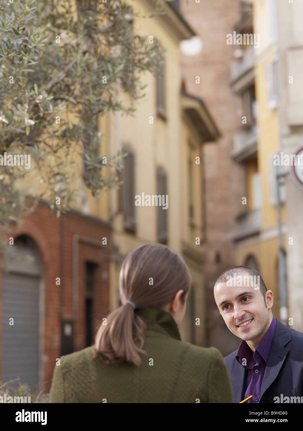 Man and woman in European street - Stock Image