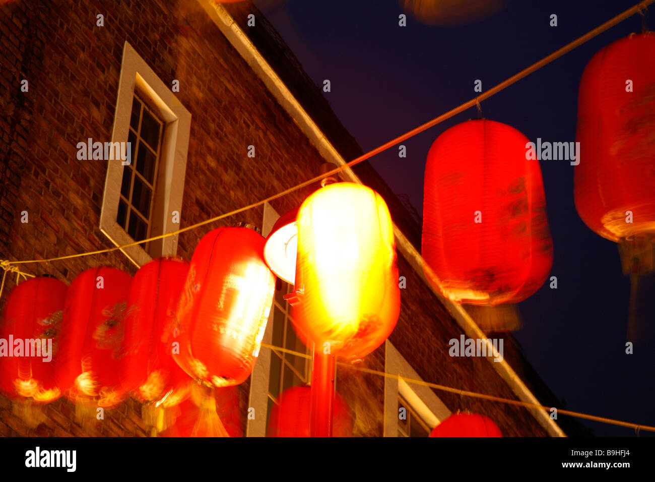 Paper lanterns hanging above Gerrard Sreet in Chinatown, London, during Chinese New Year - Stock Image