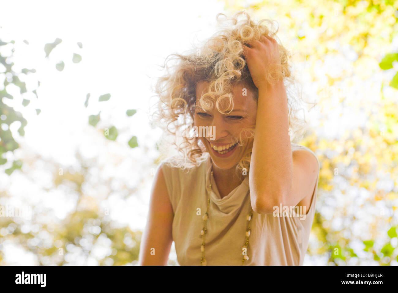 Woman laughing enjoying leisure time - Stock Image