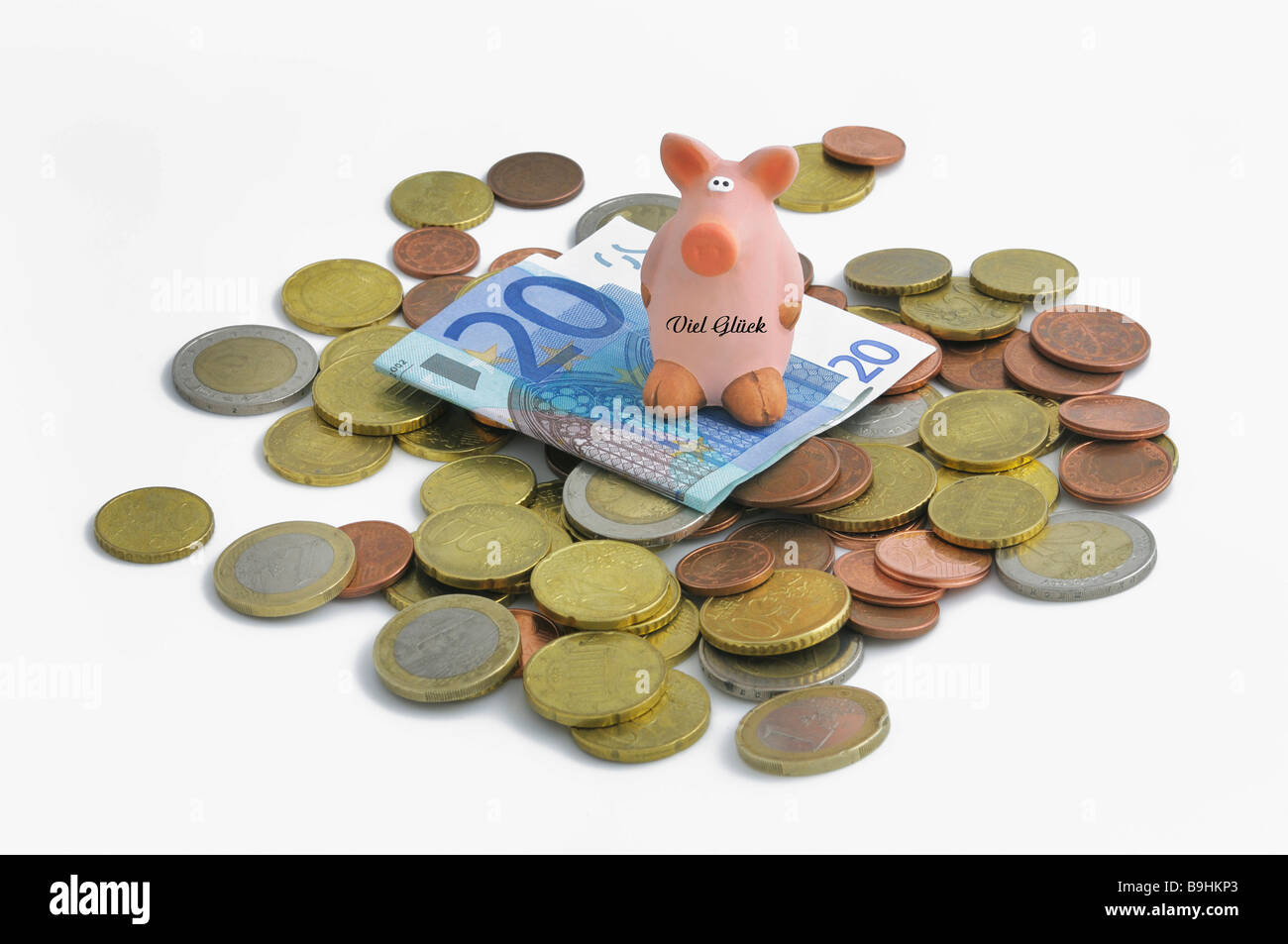 Lucky pig on euro coins and 20 euro bill - Stock Image