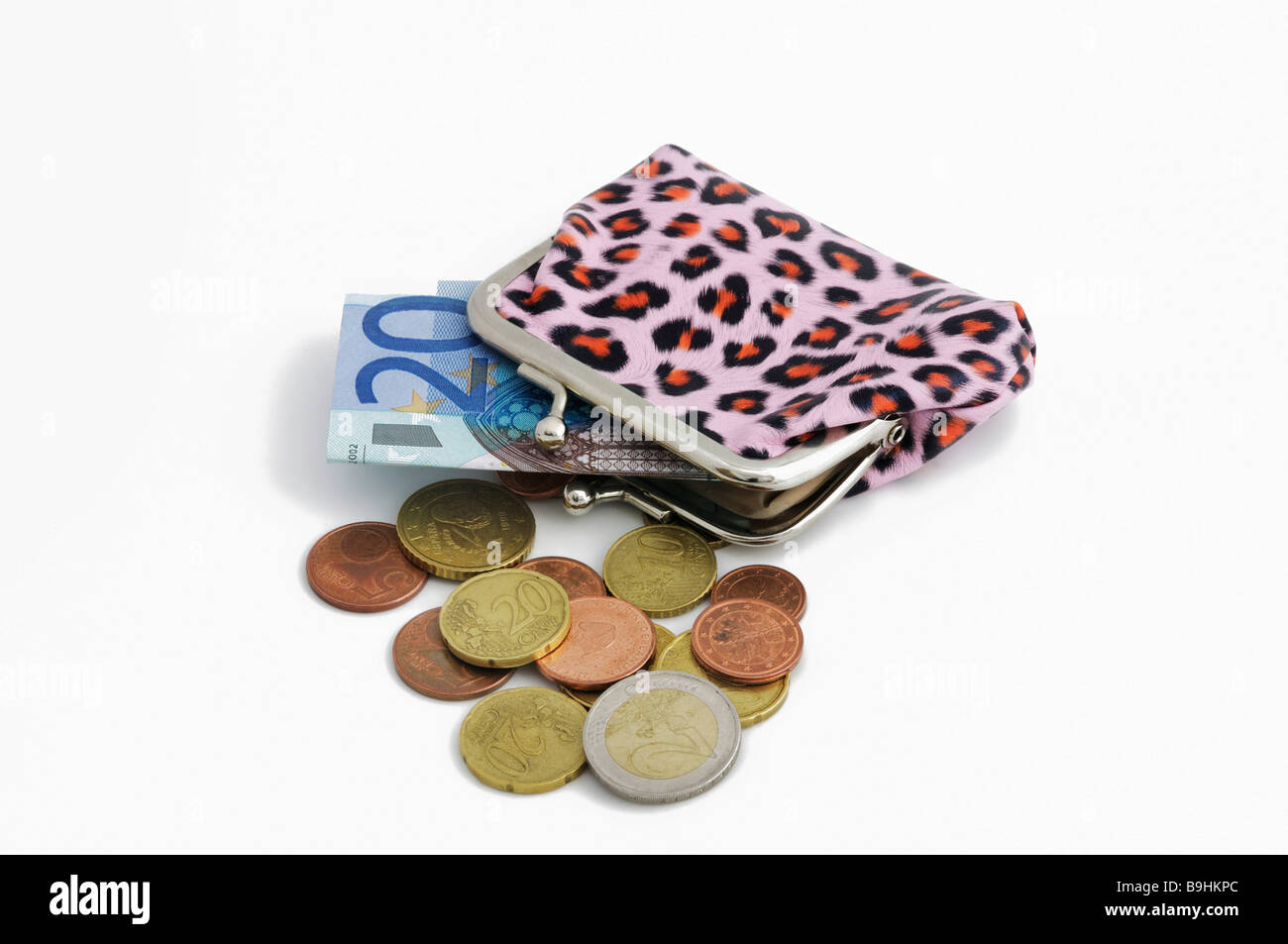 Pink purse with leopard pattern, euro coins and 20 euro bill Stock Photo