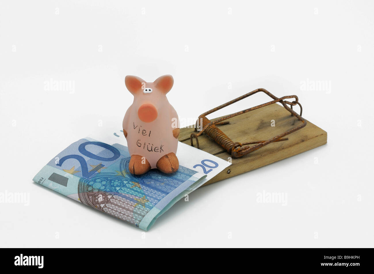 Lucky pig and a 20 euro bill on a mouse trap - Stock Image