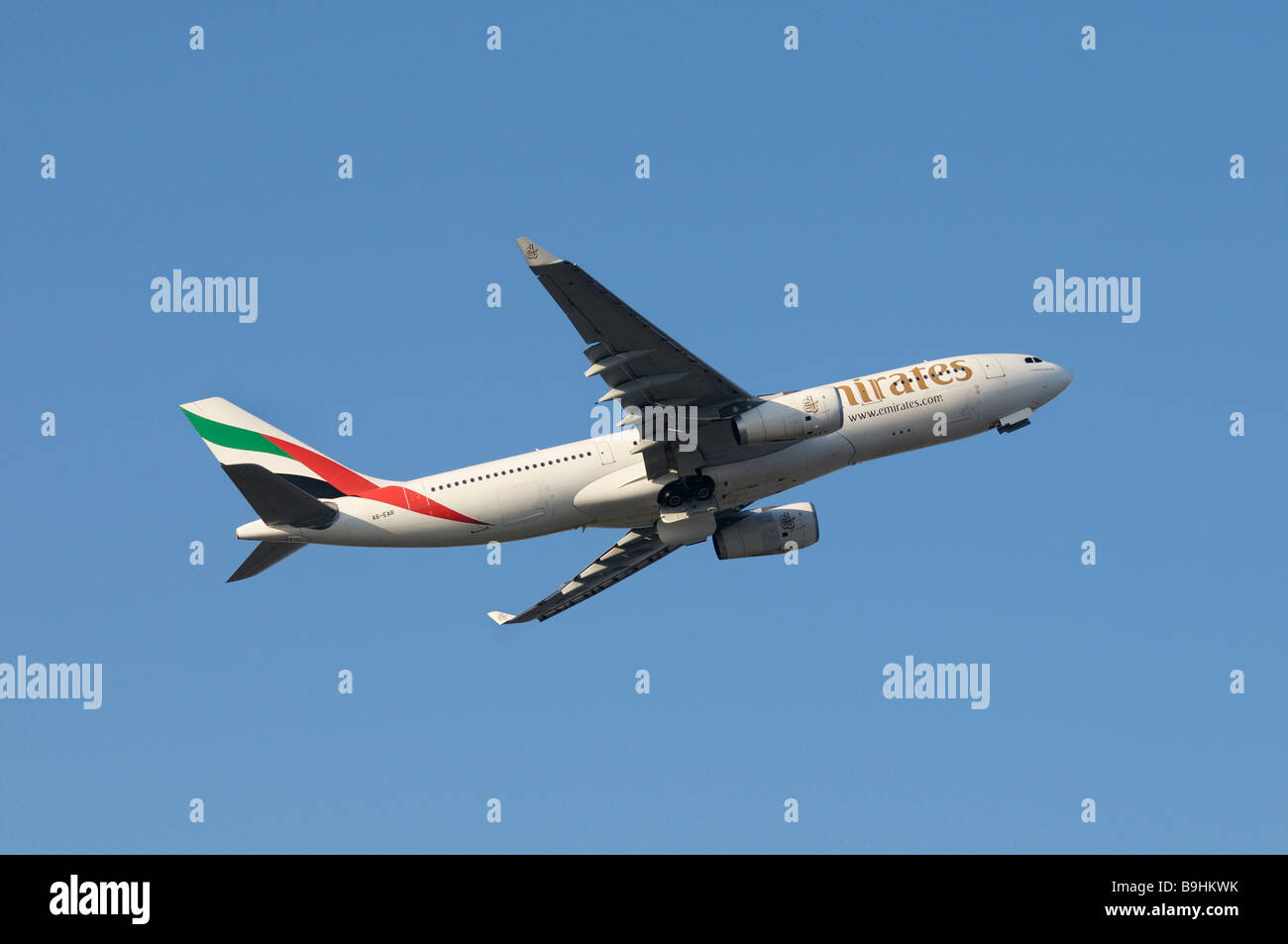 Emirates commercial aircraft Airbus A330-200 during climb flight - Stock Image