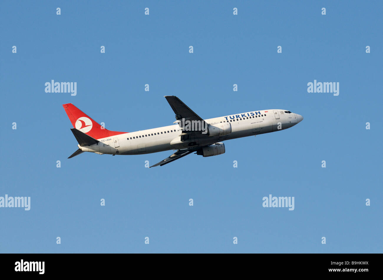Turkish Airlines commercial aircraft Airbus Boeing 737-800 during climb flight - Stock Image