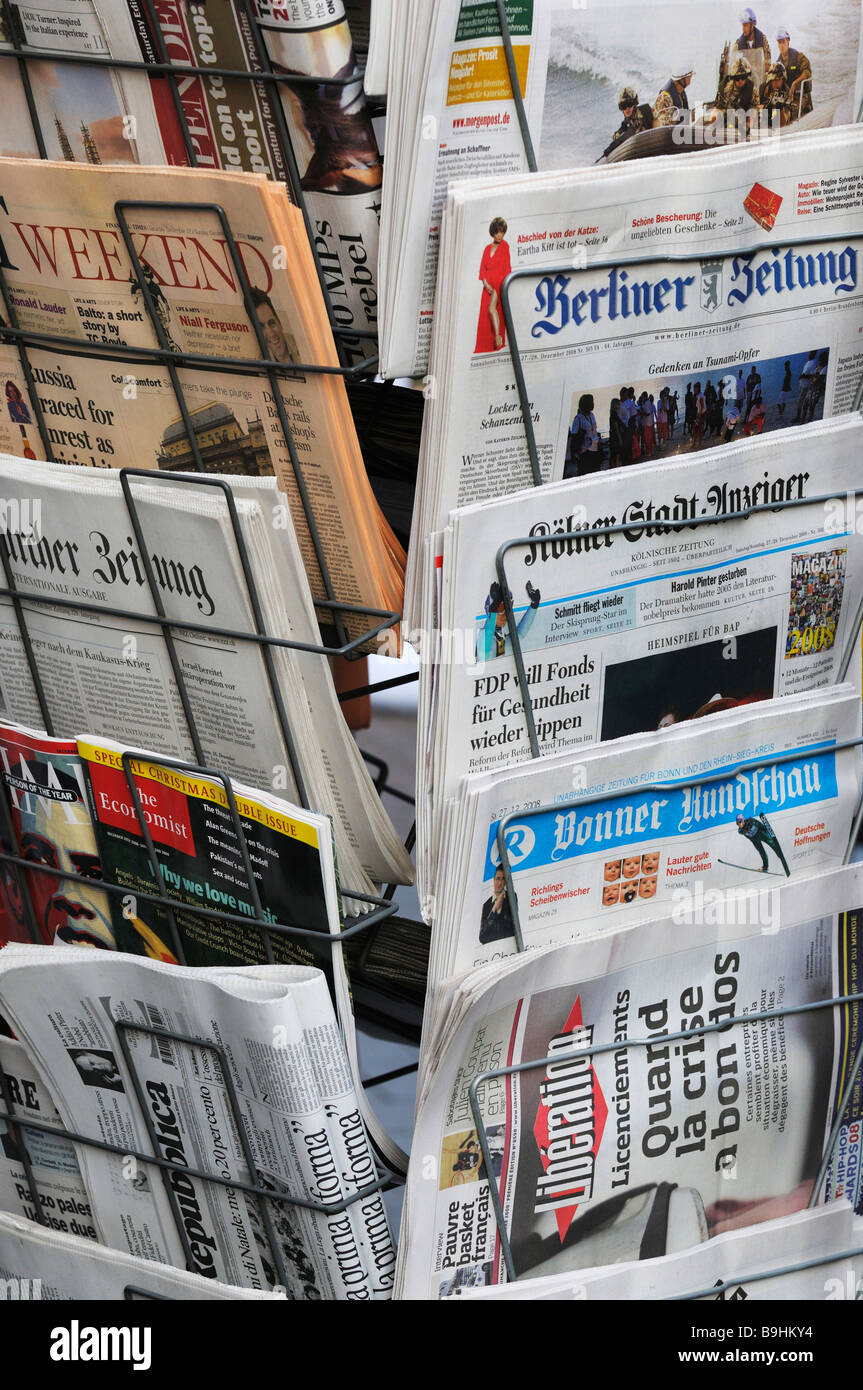 News rack with international daily newspapers - Stock Image