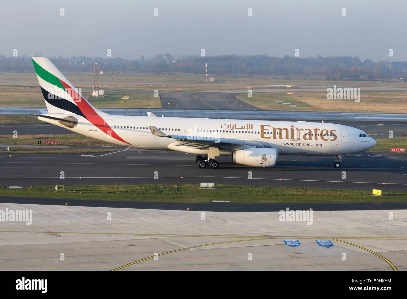 Emirates airliner on the runway, Duesseldorf International Airport, North Rhine-Westphalia, Germany, Europe - Stock Image