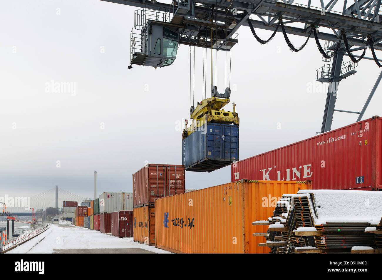 Container handling via portainer at Bonn Harbour, snow