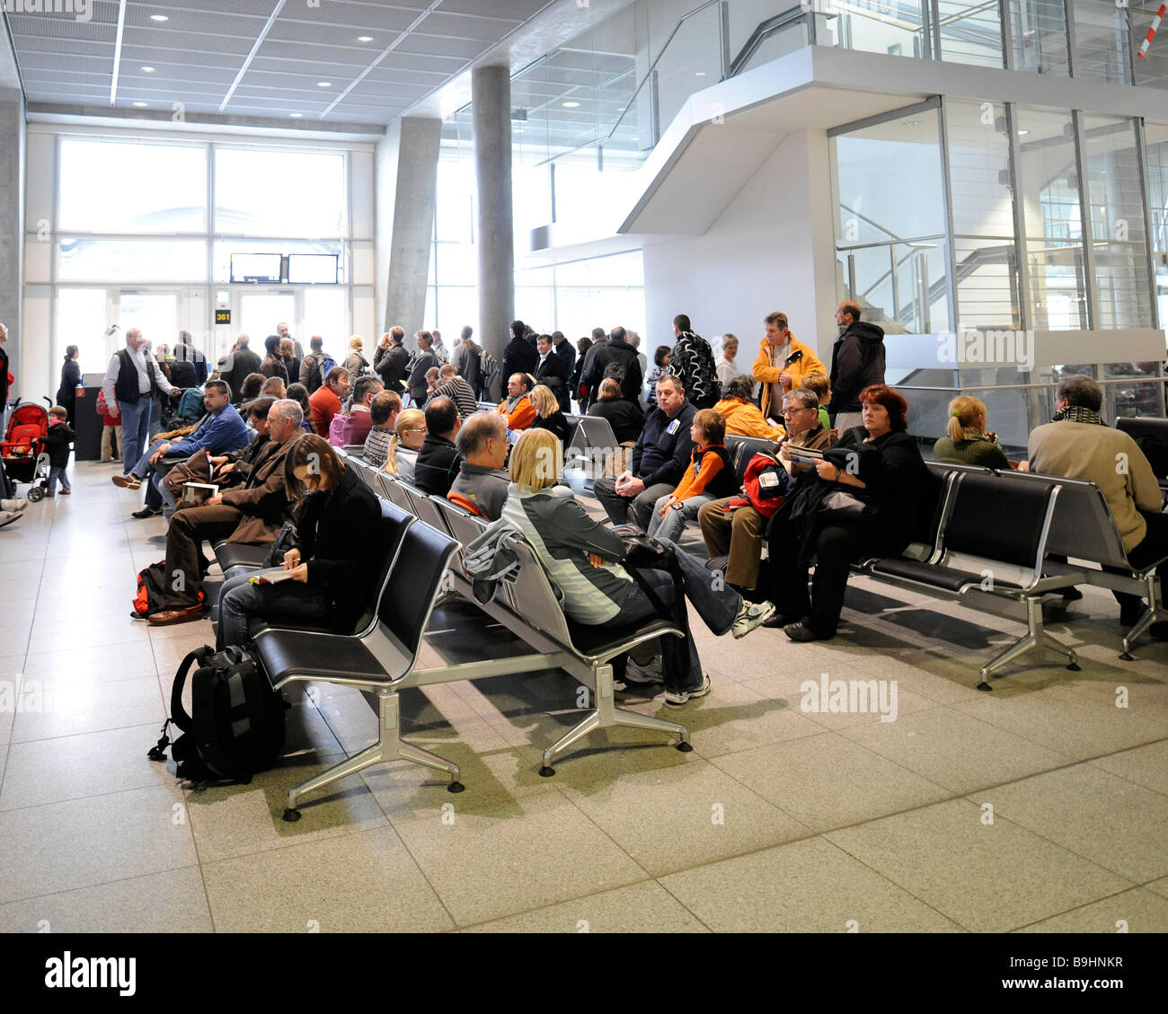 Airline passengers in the waiting area at a boarding gate, Stuttgart Airport, Baden-Wuerttemberg, Germany, Europe - Stock Image