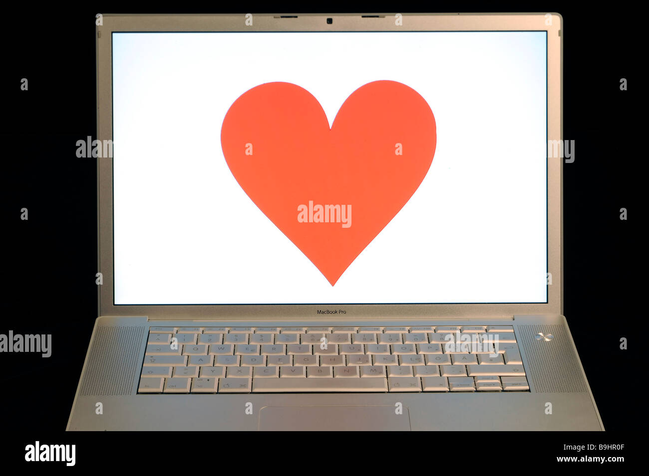 Heart on an Apple MacBook Pro screen, symbol for online dating Stock