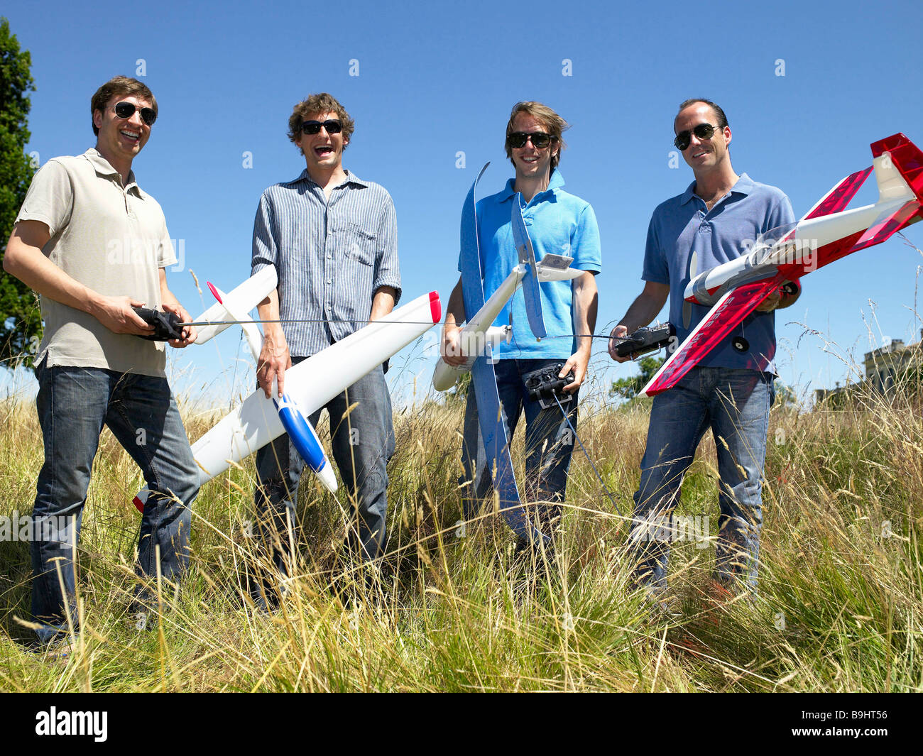Men with remote-controlled plane - Stock Image