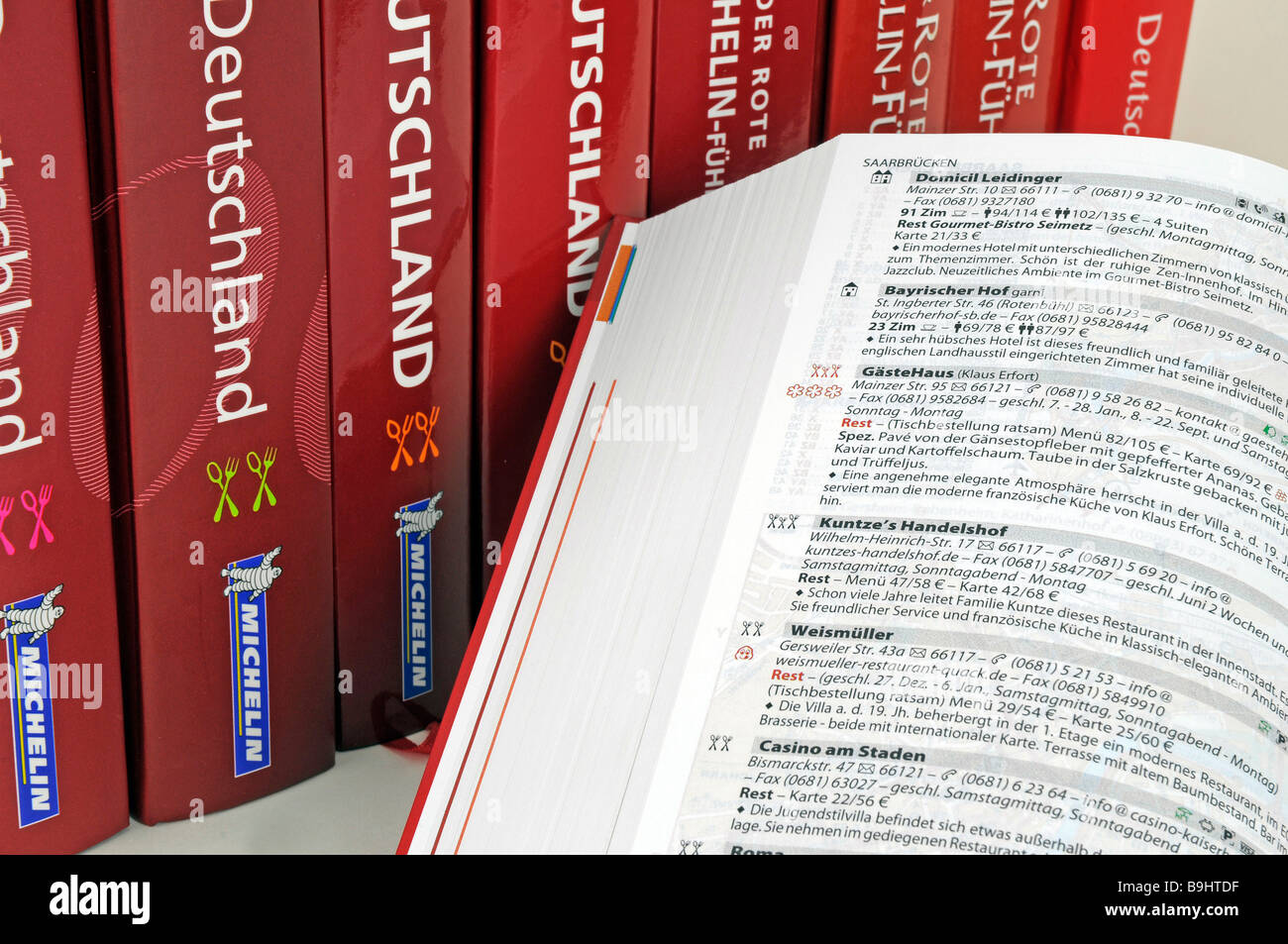 Michelin Guide for Germany with description of a 3-Star restaurant - Stock Image