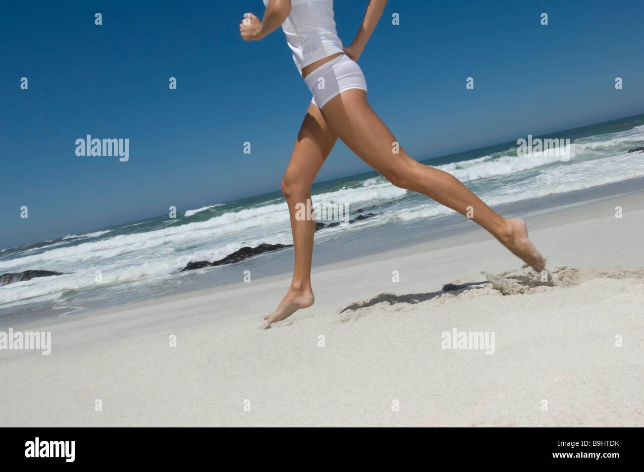 Female running on beach Stock Photo