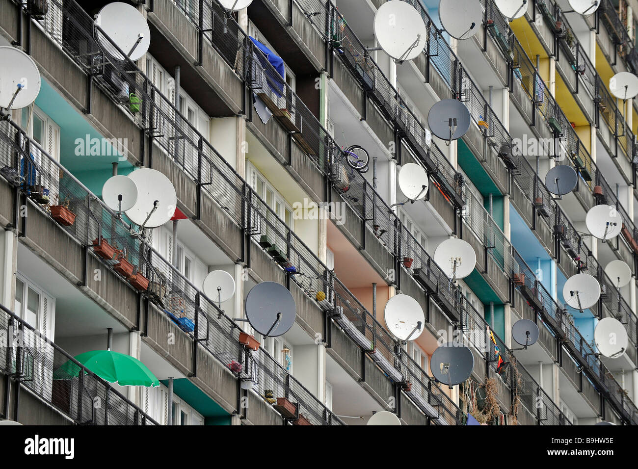 Satellite dishes on a seventies tenement building, Berlin, Germany, Europe - Stock Image