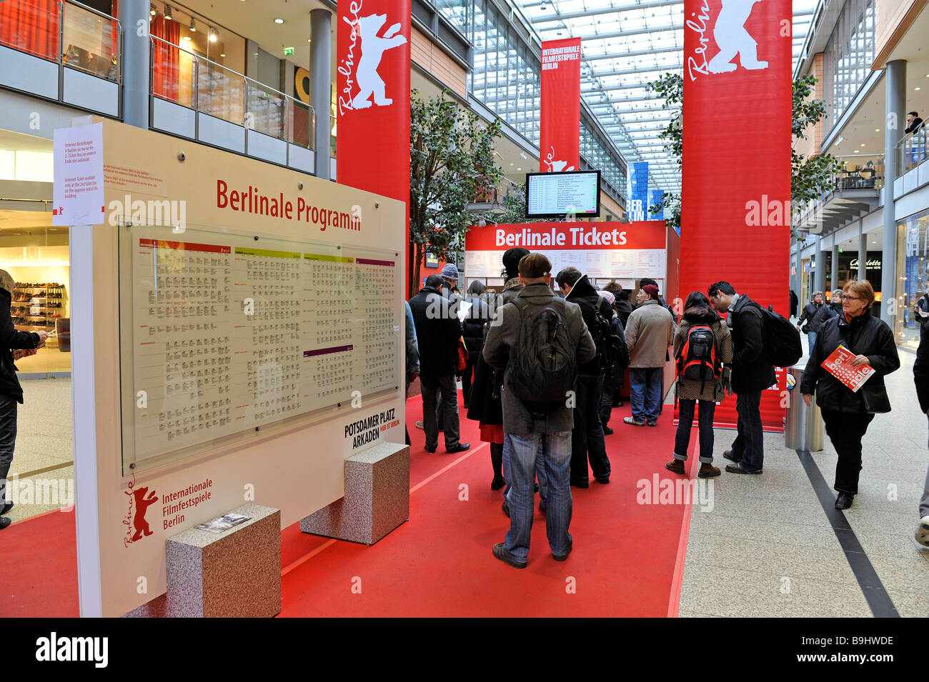 Visitors of the Berlinale buying tickets for the cinema, reading the program, Berlin, Germany, Europe - Stock Image