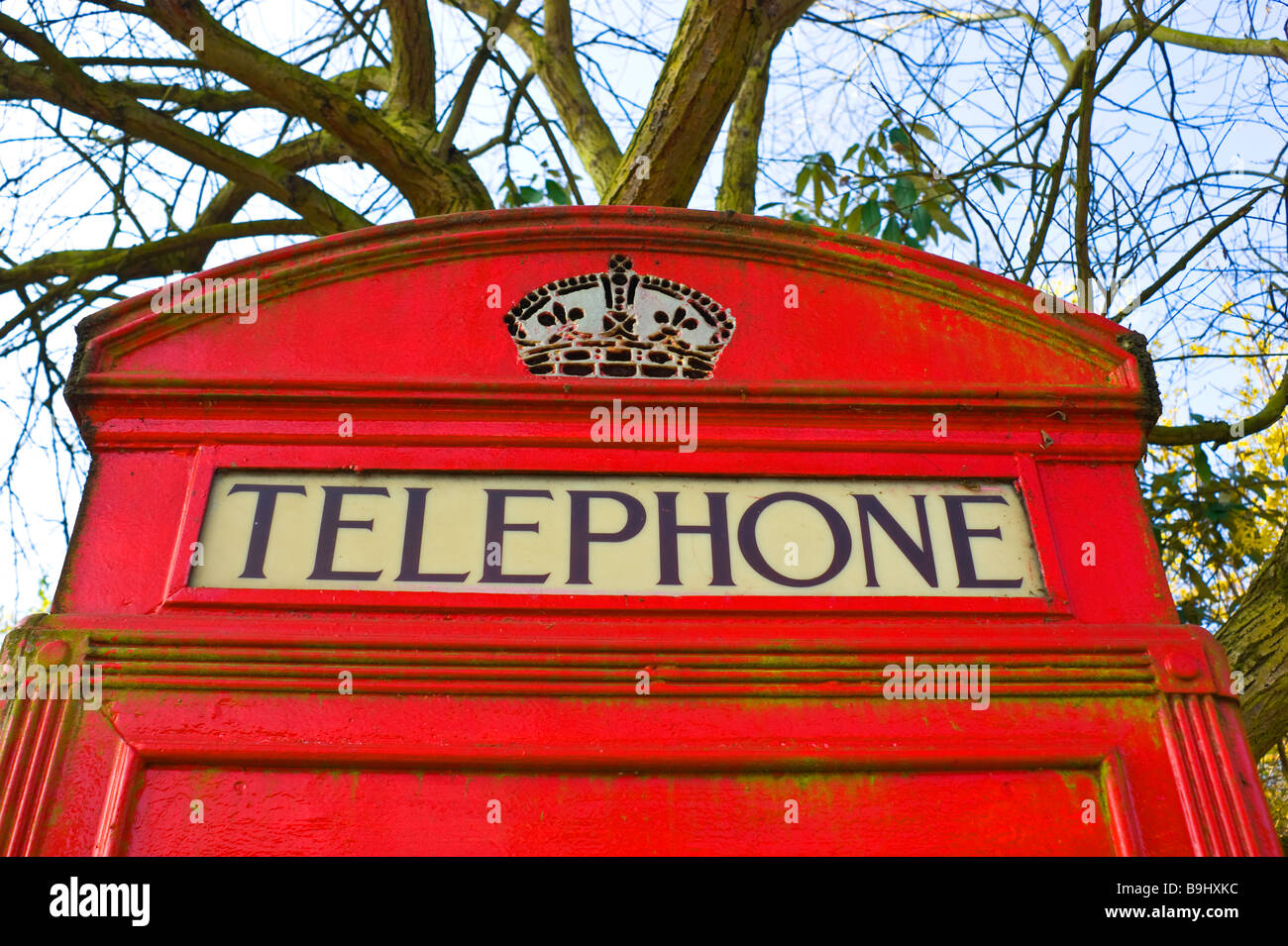 Close up of antique Red London telephone kiosk still in operation in Highgate North London. - Stock Image