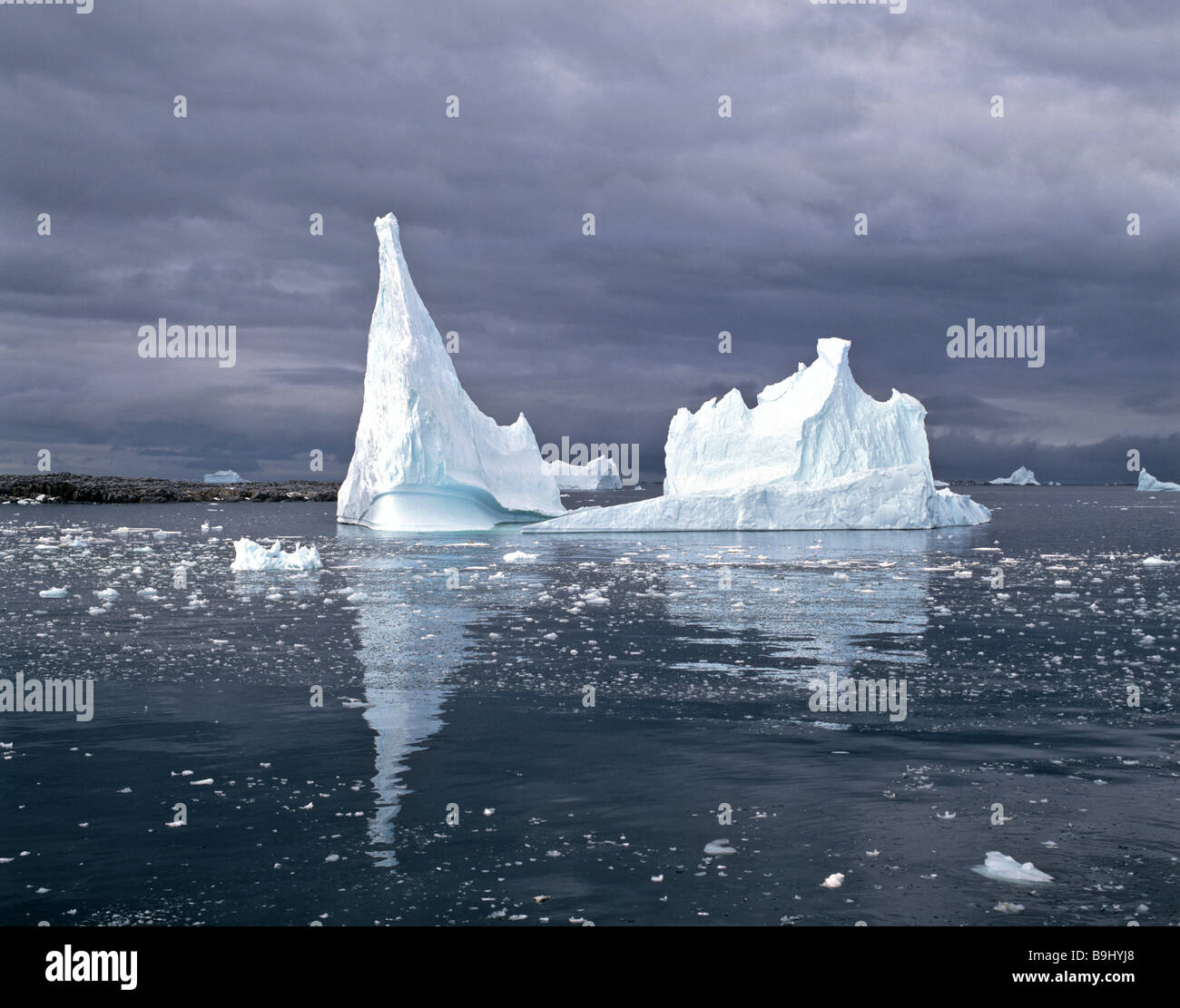 Pointy iceberg floating in the polar sea, ice tower, Antarctic - Stock Image