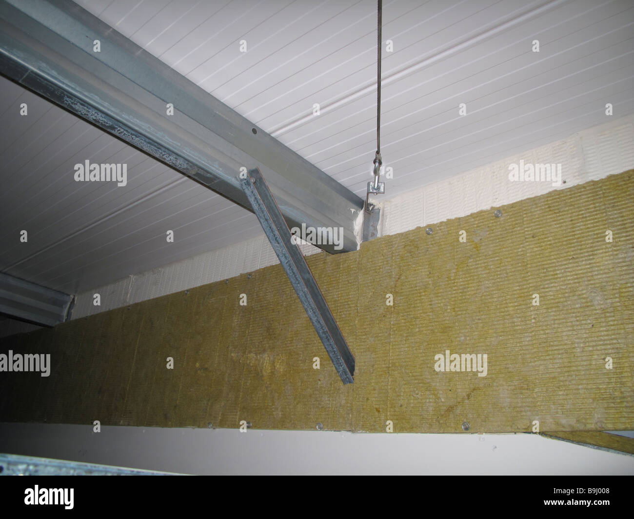 Fire stopping in ceiling void above suspended ceiling - Stock Image