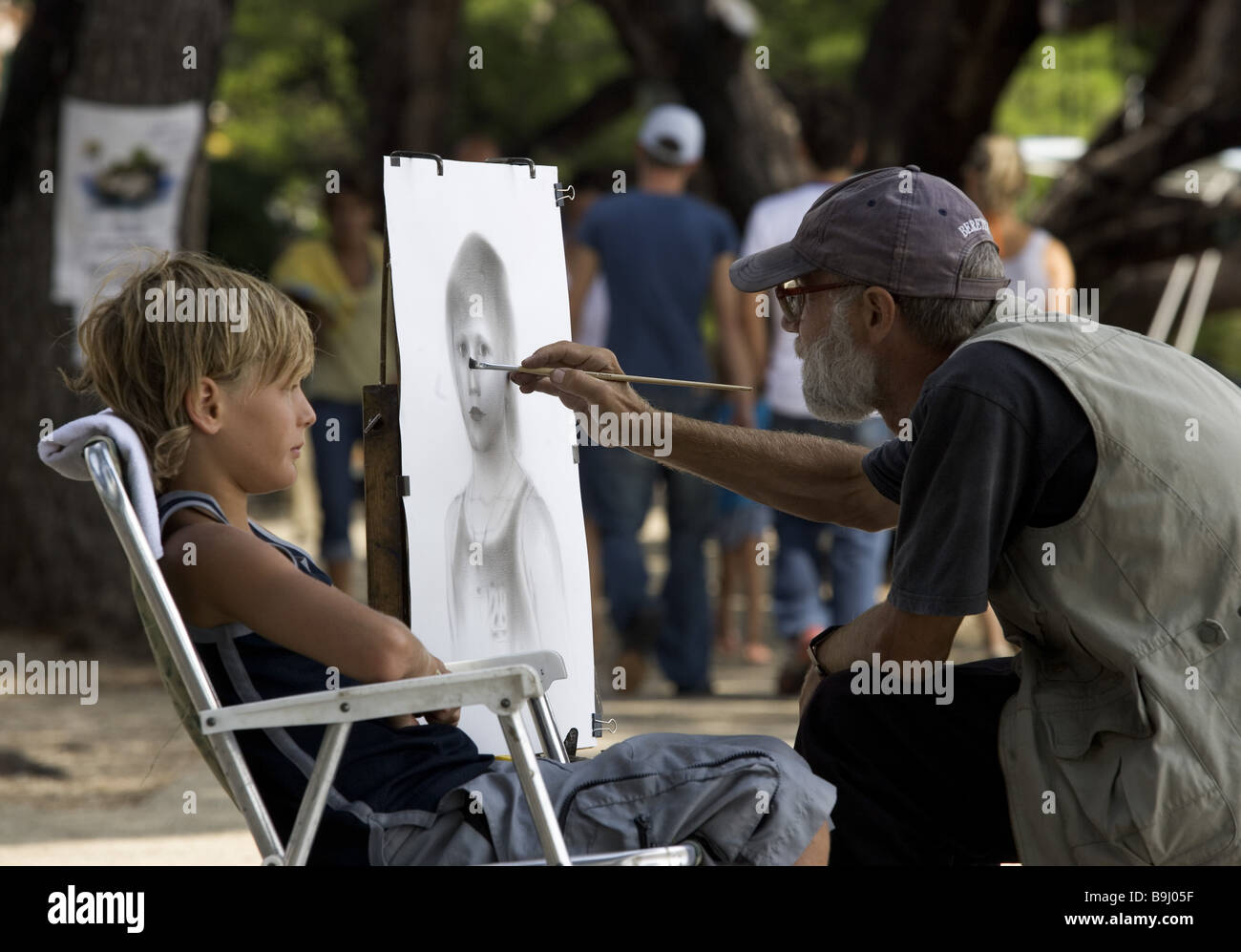 Artists canvas boy portrays at the side no models release series art brushes drawing paper paintings portrait child - Stock Image