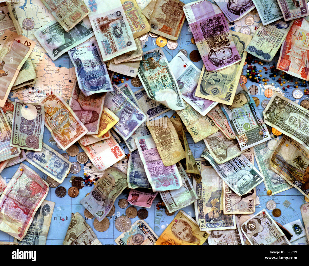 Old banknotes and coins, international currencies, global currencies - Stock Image