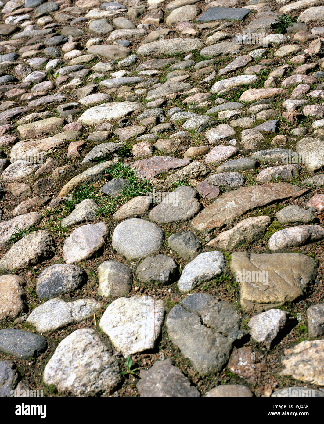 Natural cobble-stoned pavement - Stock Image
