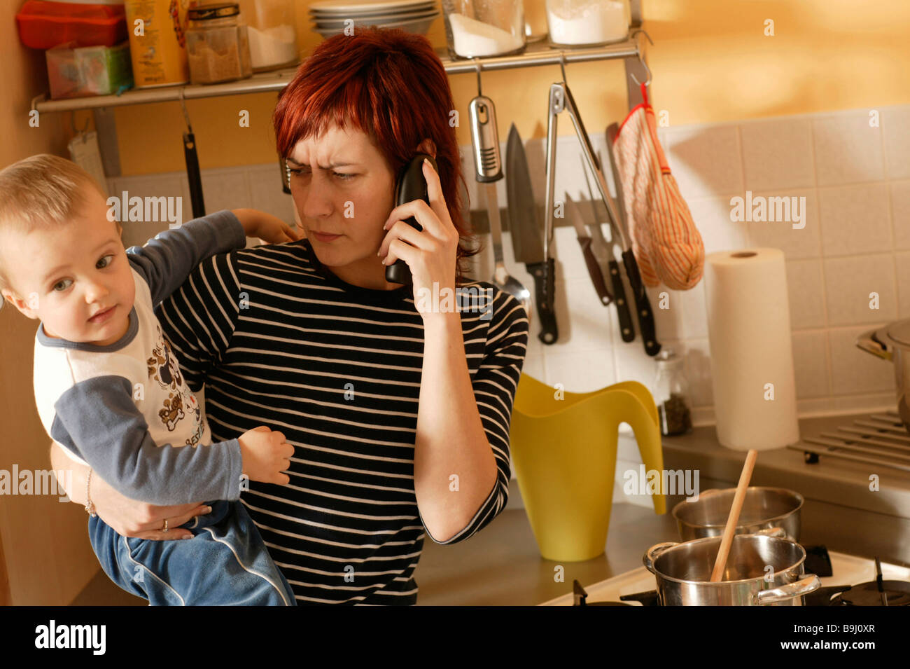 Mother with child, stress - Stock Image