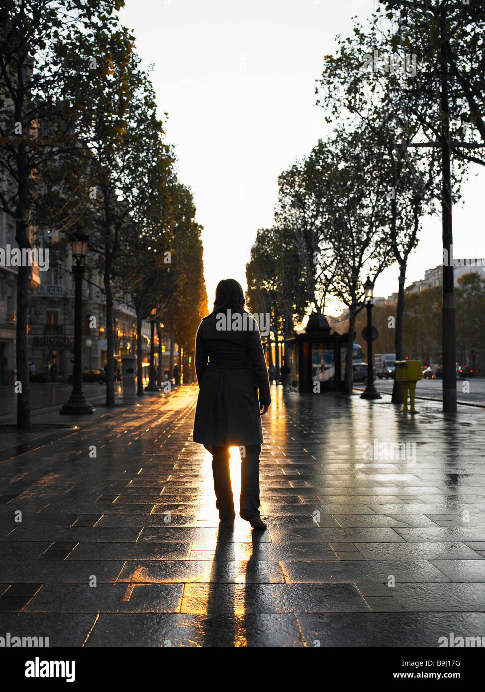 Woman walking on Champs Elysees - Stock Image