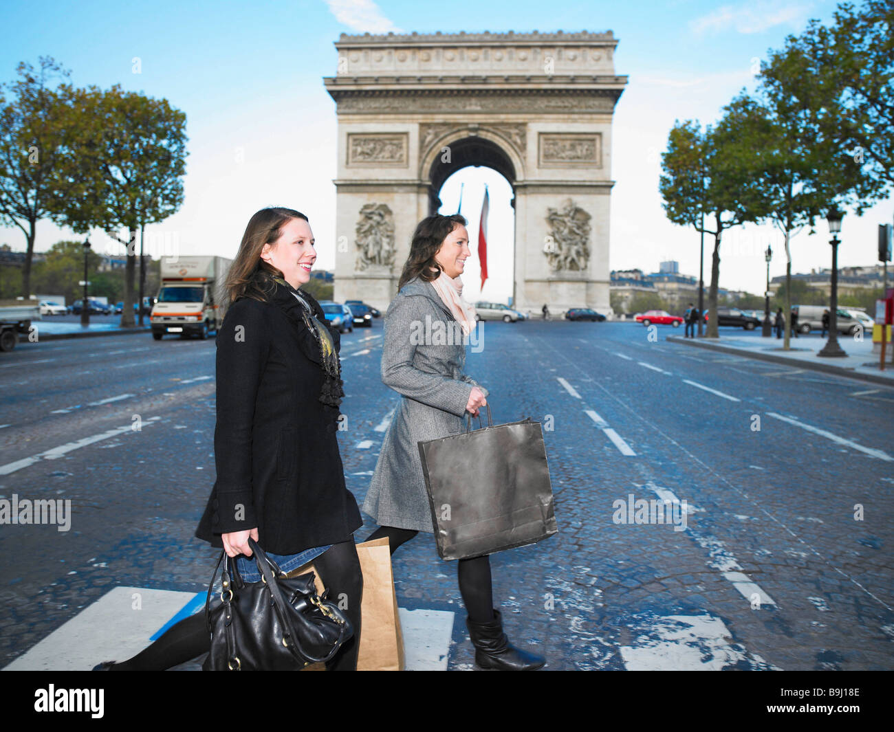 Women walking on Champs Elysees - Stock Image
