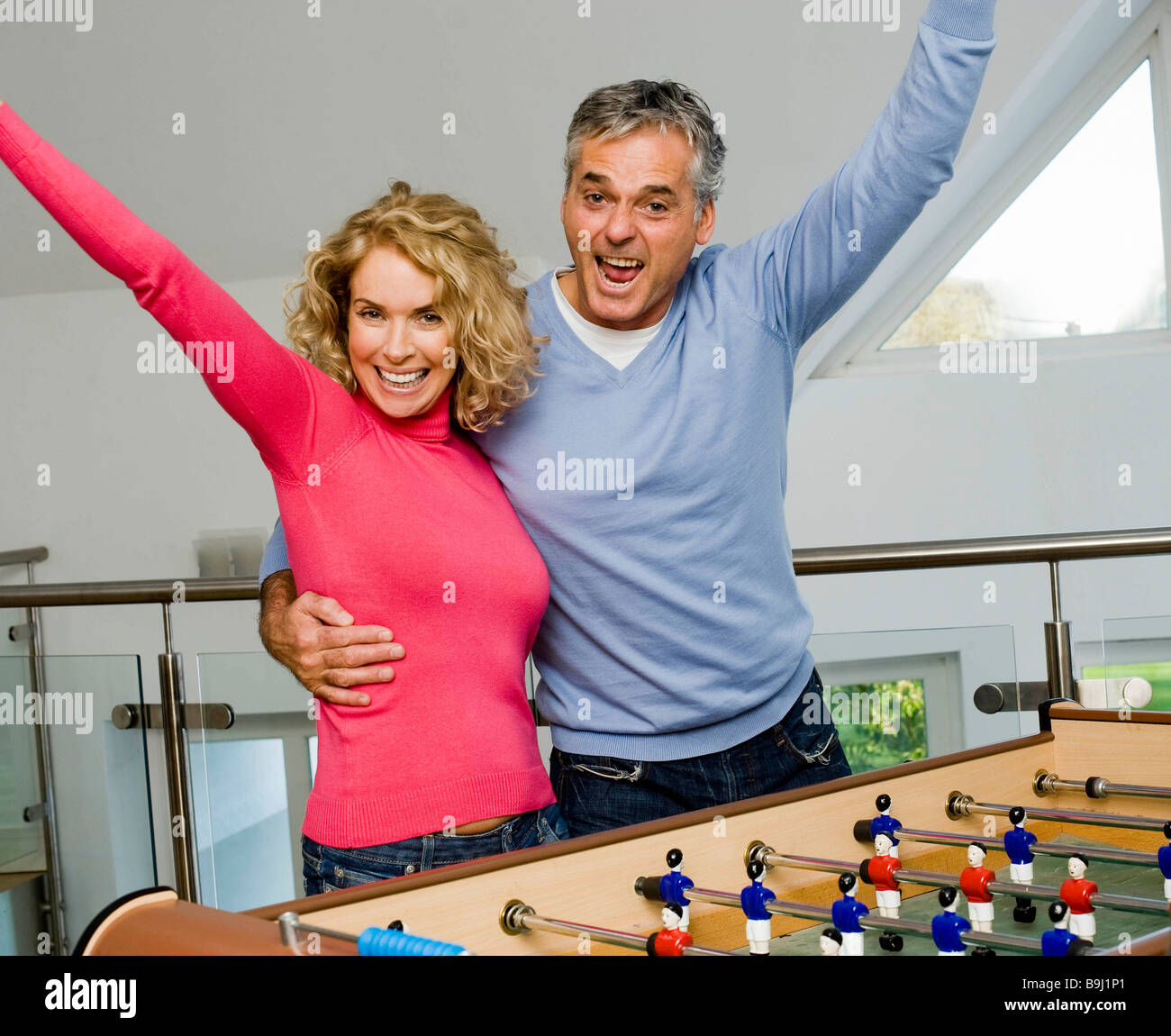Couple having fun playing table football - Stock Image