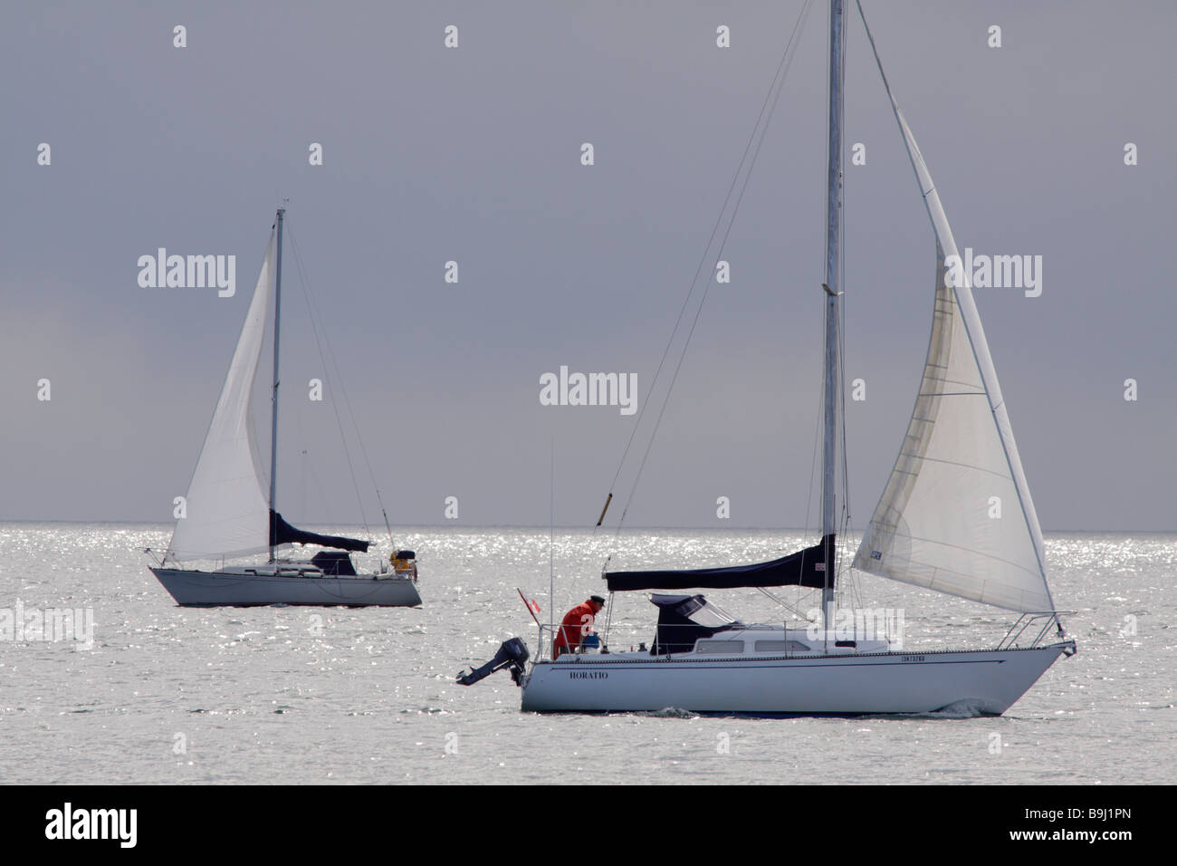 Sailboats in Juan de Fuca Strait on spring afternoon Victoria British Columbia Canada - Stock Image