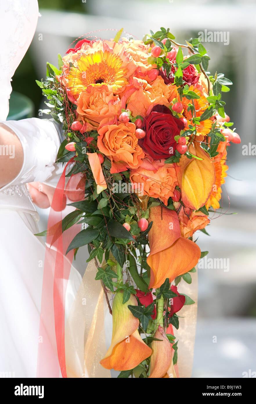 Bride detail hands gloves flower-bouquet holding sidewards woman ...