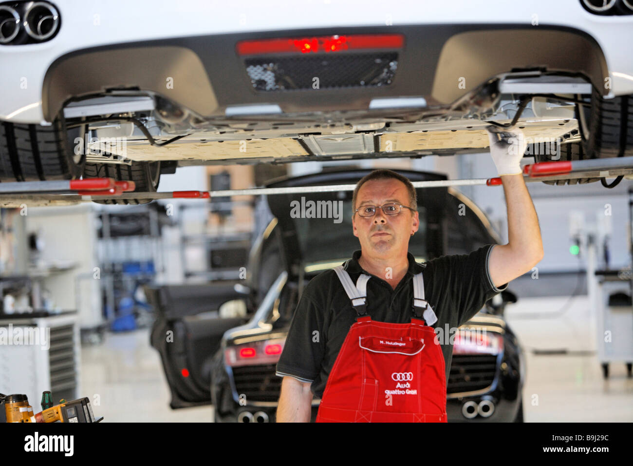 A Silverliner is an employee over 40, here during night shift at Audi R8 construction at the Audi Plant in Neckarsulm, - Stock Image