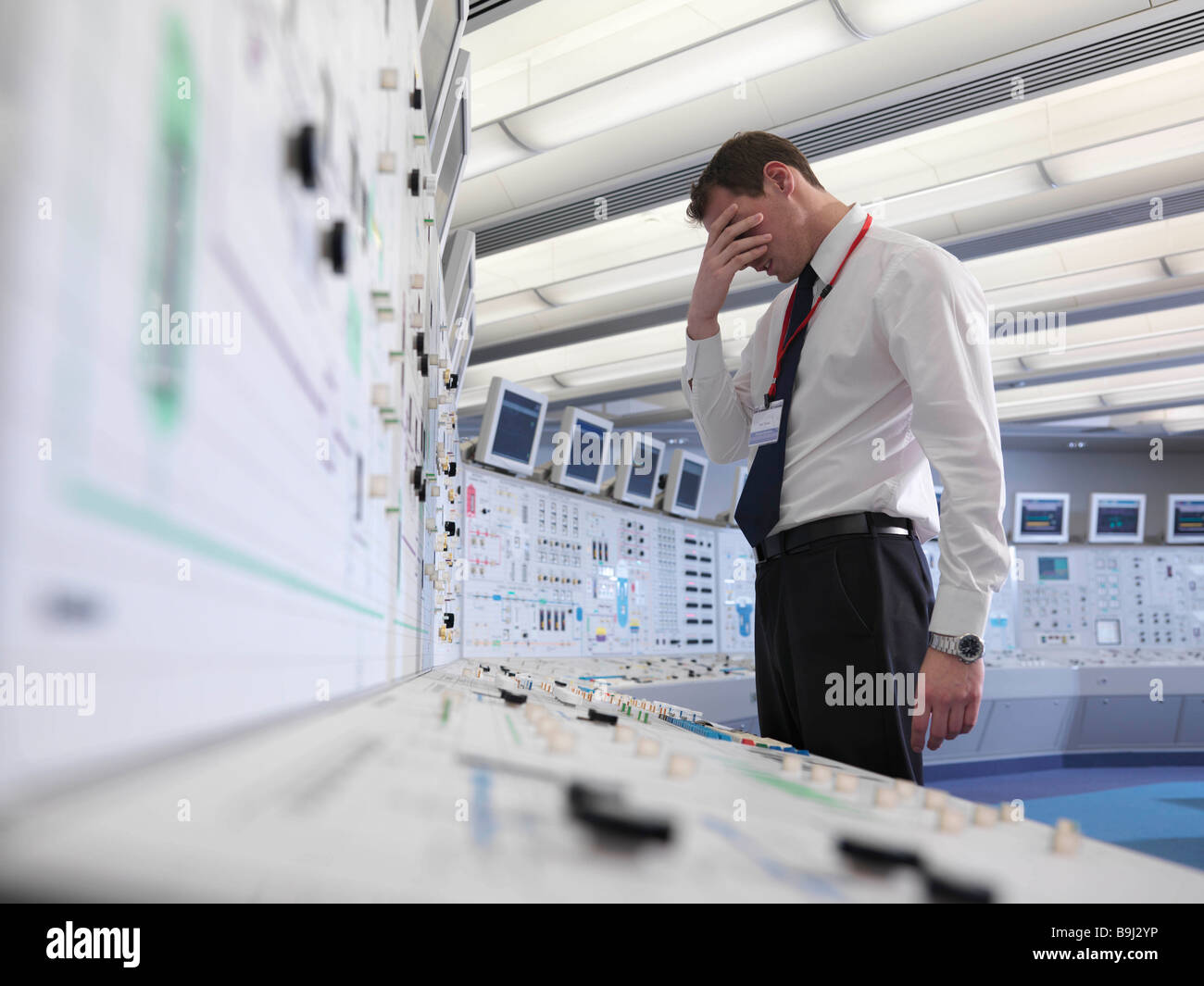 Distressed operator in control room - Stock Image
