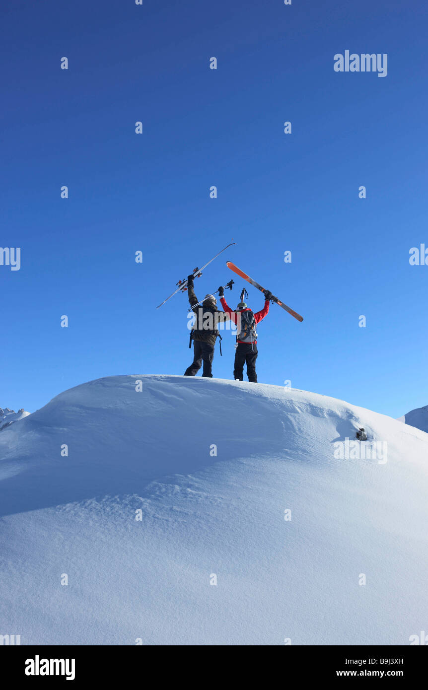 Skiers on top of mountain - Stock Image