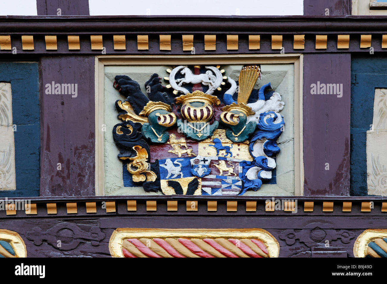 Medieval coat of arms on a half-timbered house, colourfully painted, former cathedral provost, Halberstadt, Harz, Stock Photo