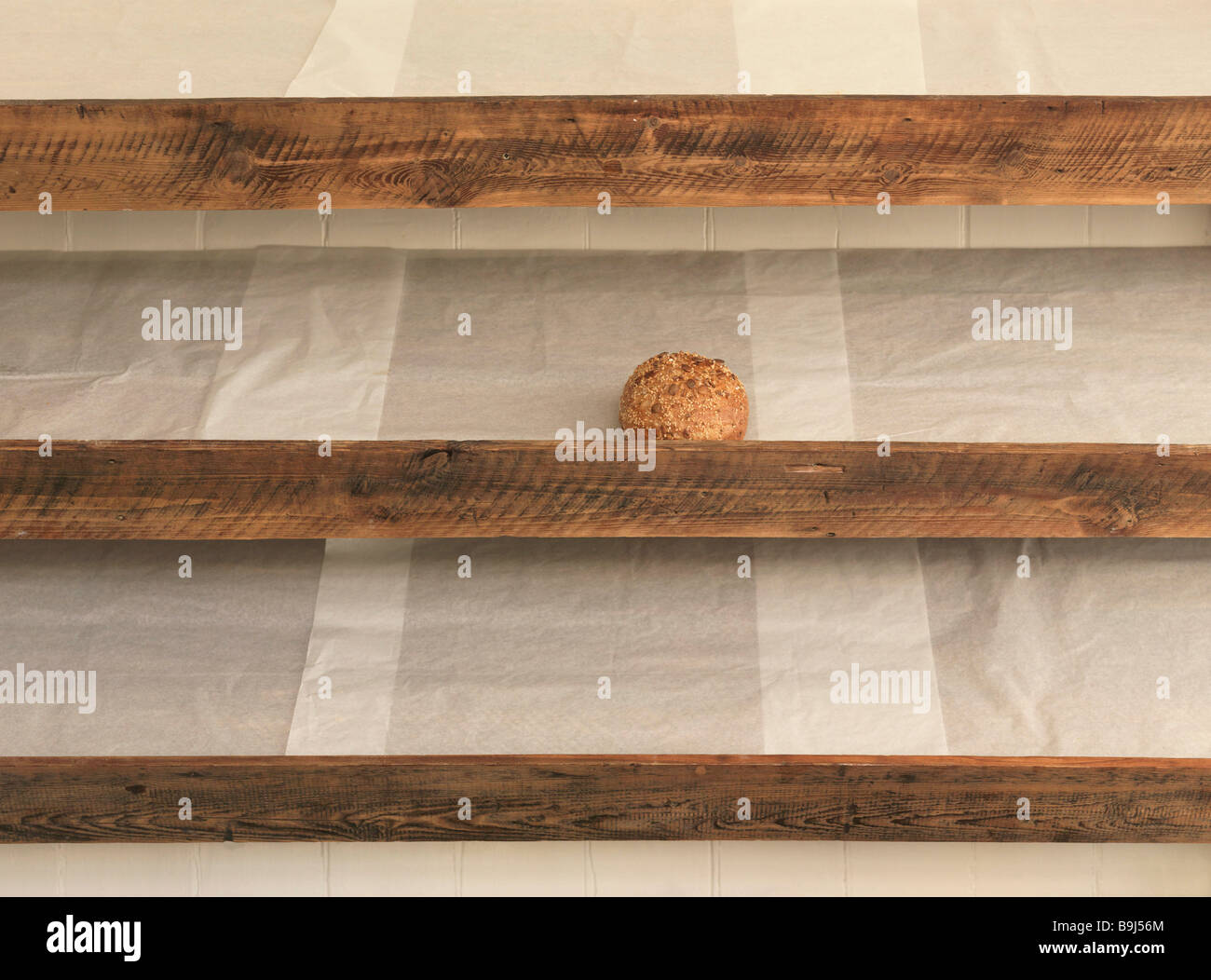 Sole remaining bread on shelf in bakery - Stock Image