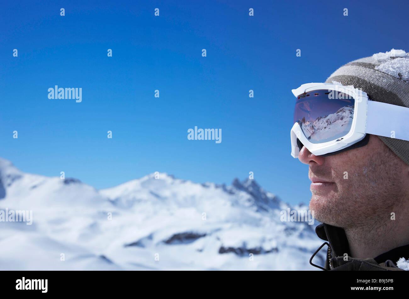 Portrait of man wearing ski goggles - Stock Image