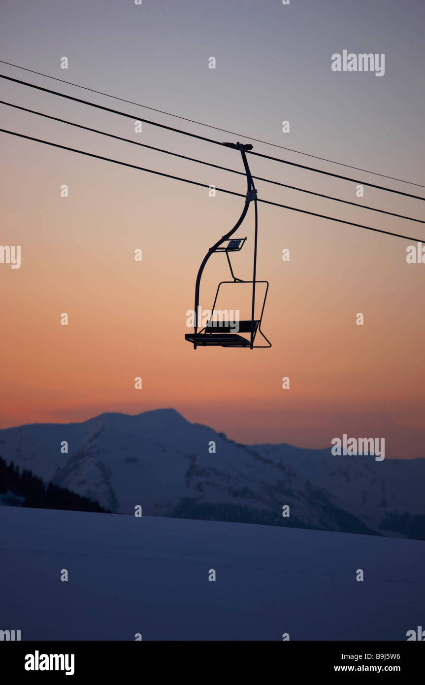 Mountain view at dusk with chair lift - Stock Image