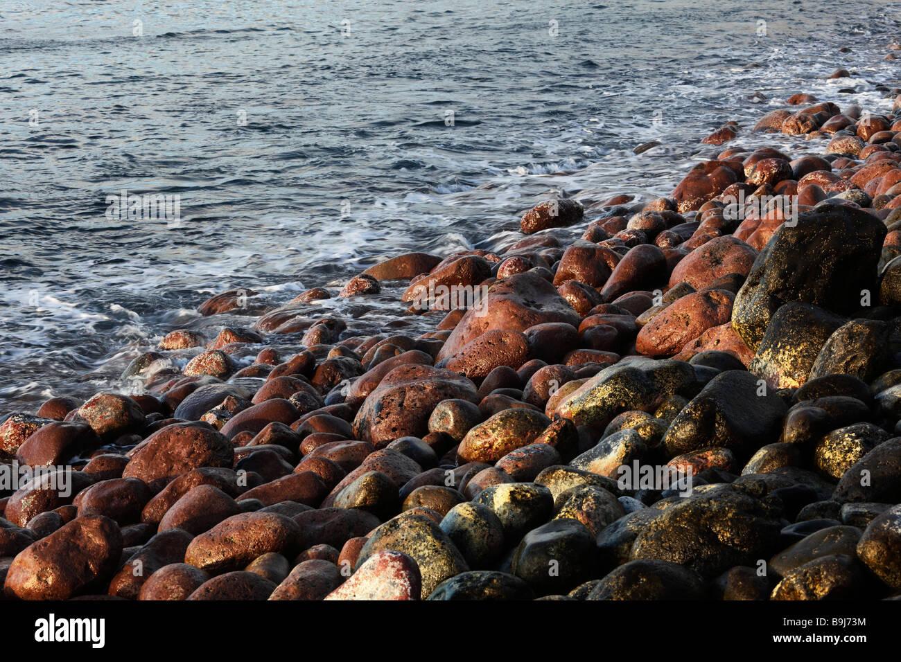 Red and black stones on a beach, Playa de Santiago, La Gomera, Canary Islands, Spain, Europe - Stock Image
