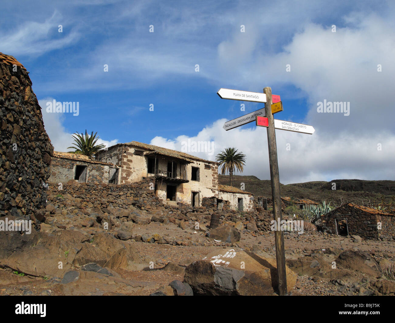 Signpost and deserted houses in Contreras near Playa Santiago, La Gomera, Canary Islands, Spain, Europe - Stock Image