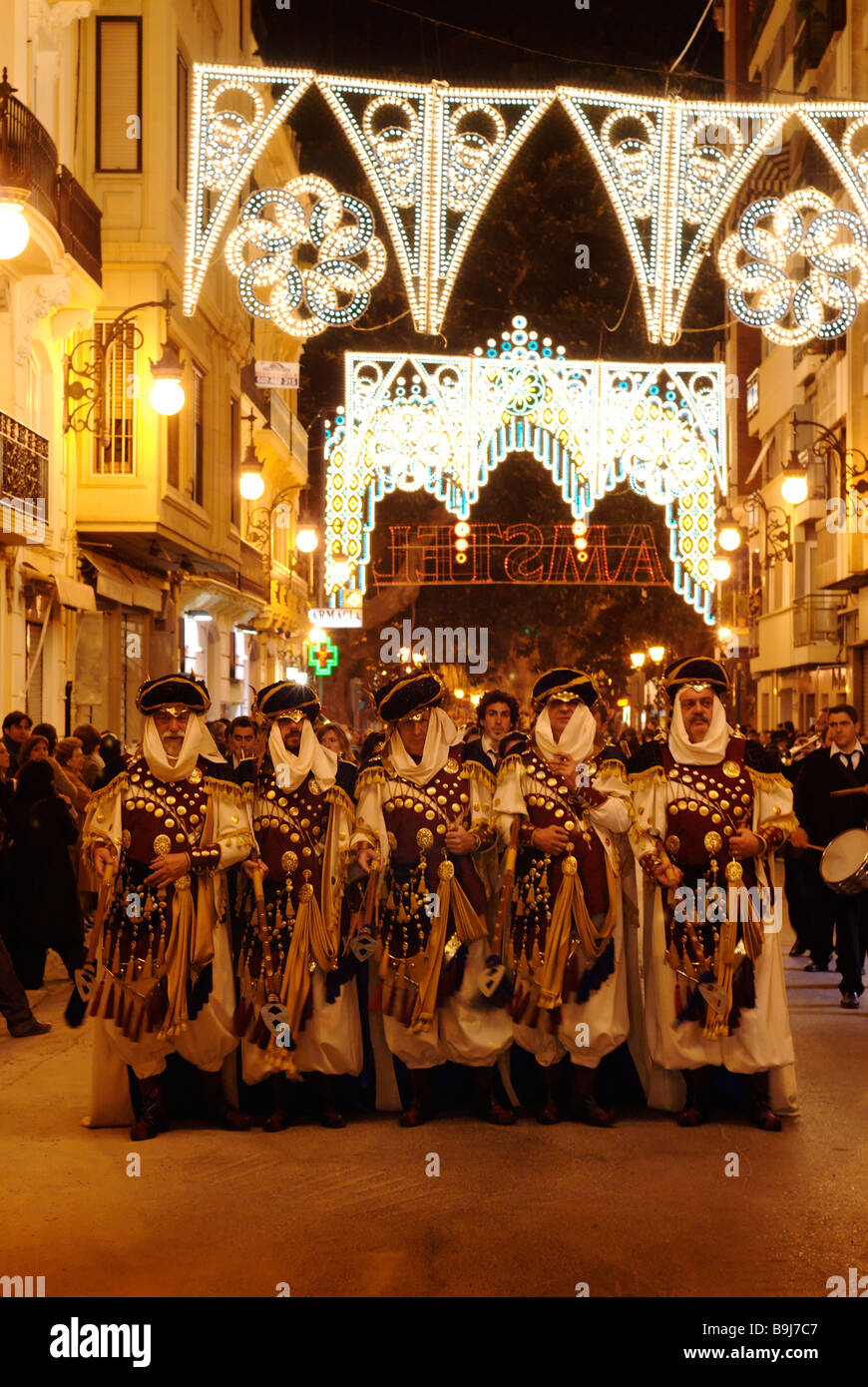 Costume parade of Arab invaders Moros during Las Fallas celebrations in the streets of Valencia Spain - Stock Image