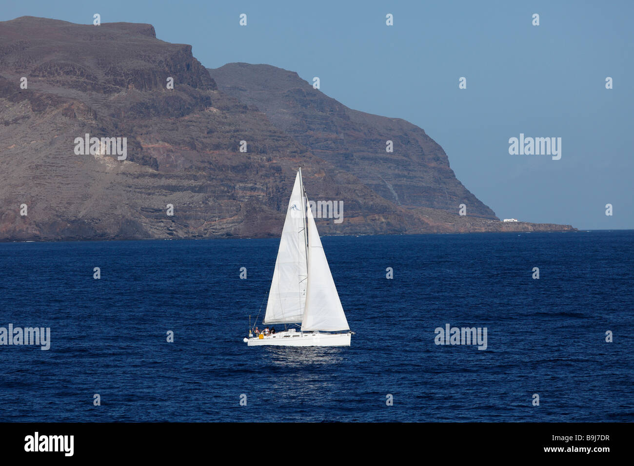 Sailing boat in front of La Gomera, Canary Islands, Spain, Europe - Stock Image