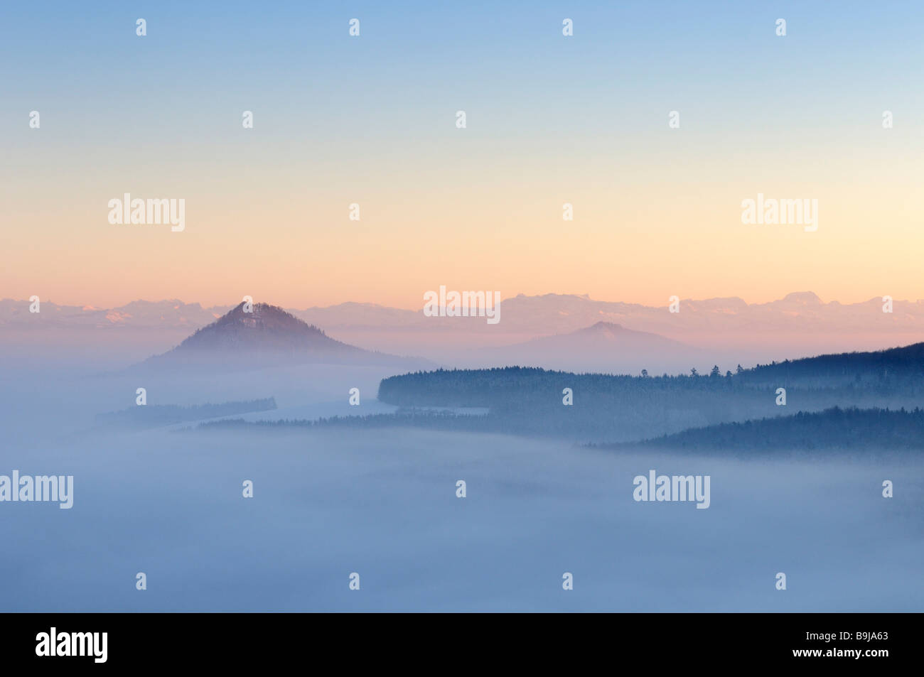 Hegau landscape with view of the Swiss Alps during an inversion, Konstanz district, Baden-Wuerttemberg, Germany, - Stock Image