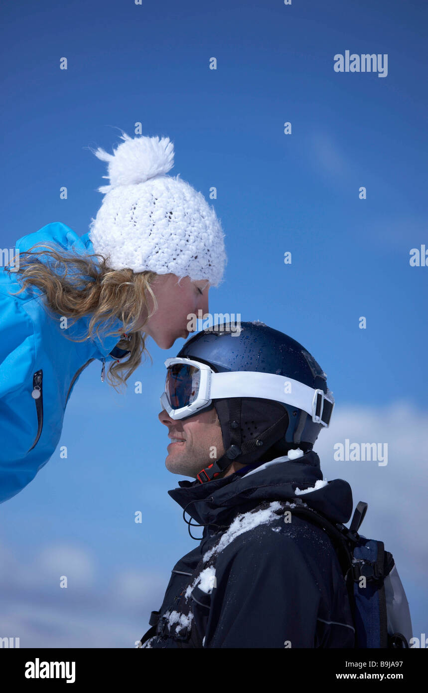 Couple sitting close in chair lift - Stock Image