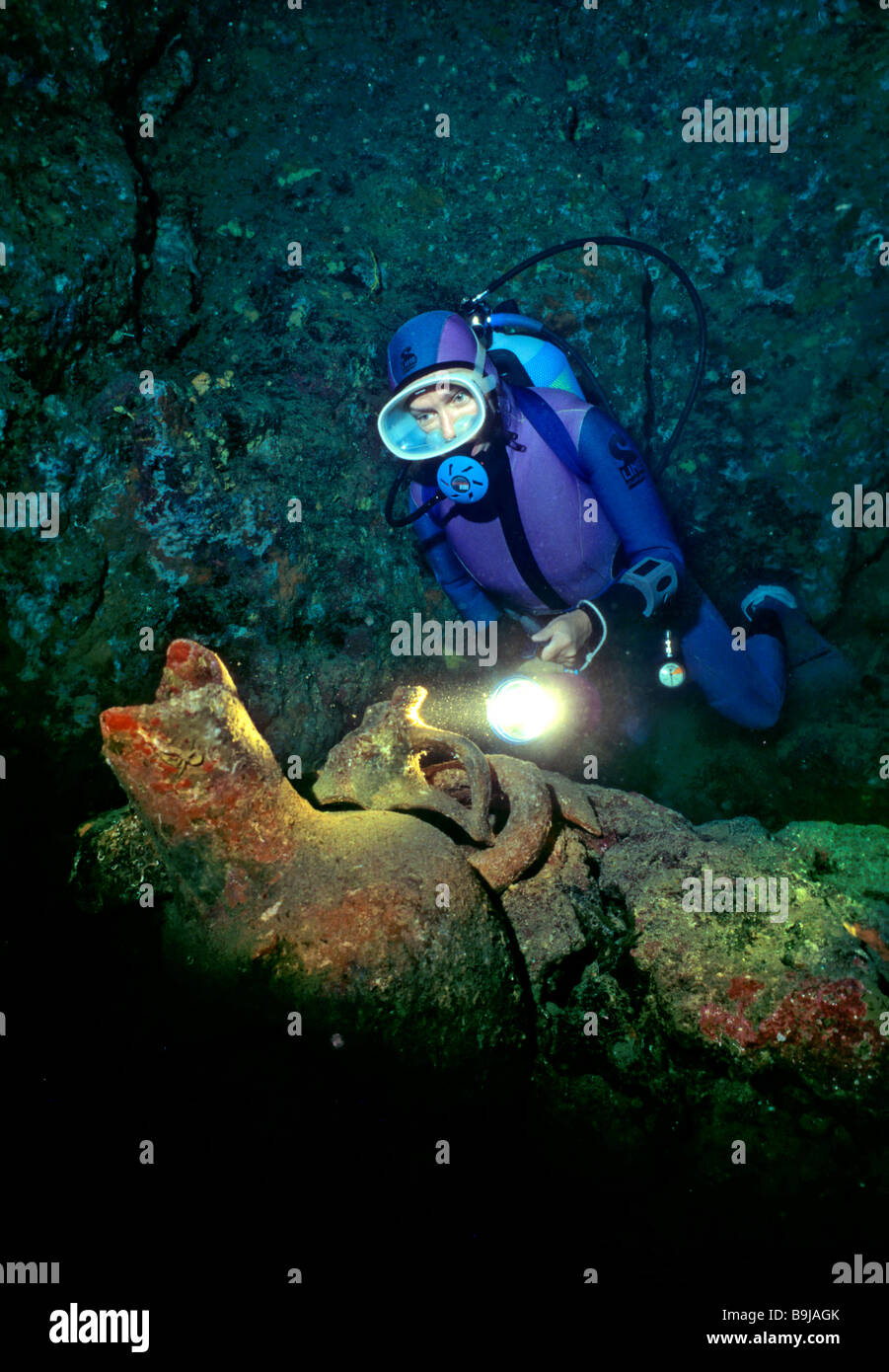 Scuba diver in an underwater cave with amphoras, Mediterranean Sea, Turkey - Stock Image