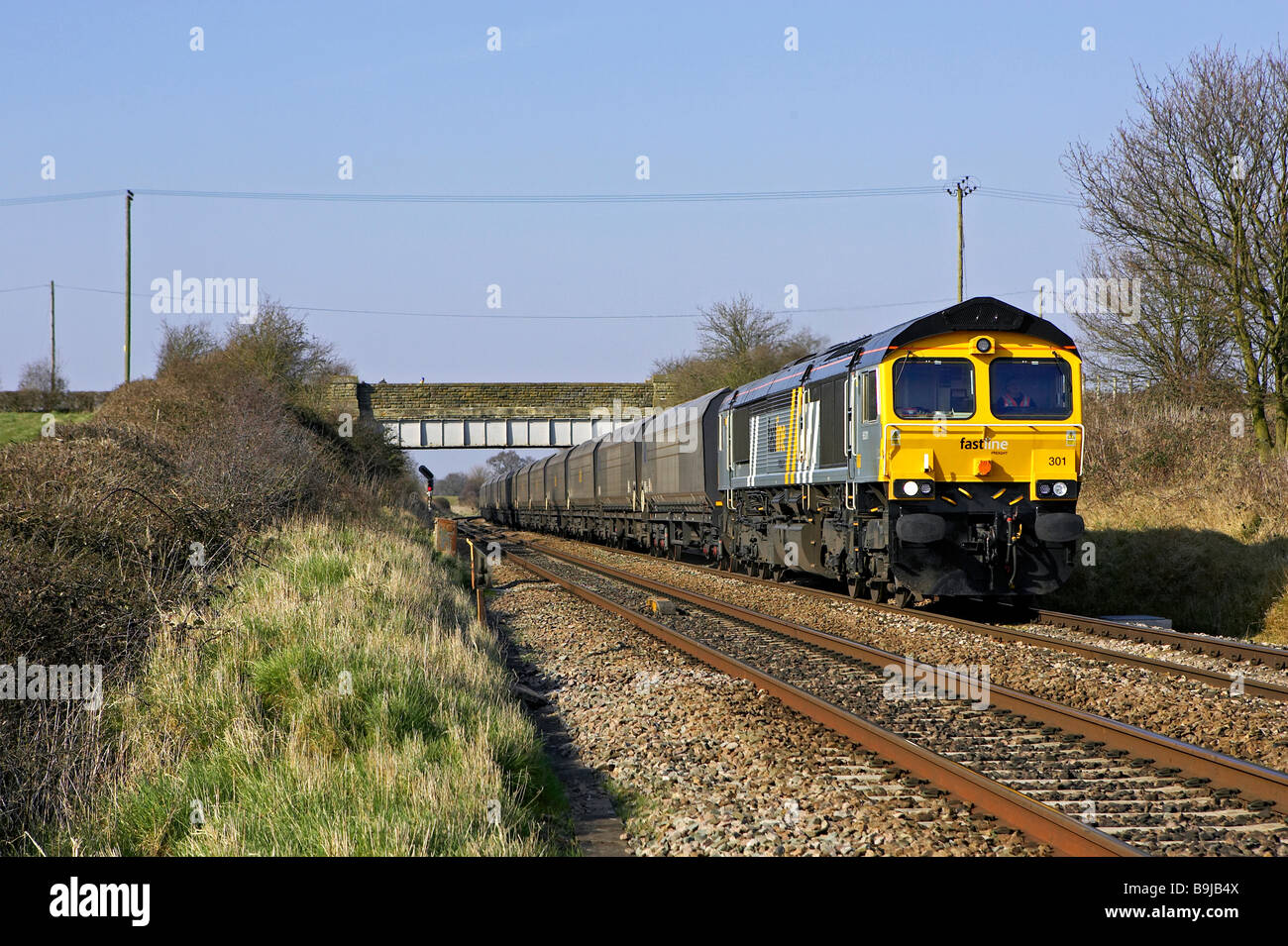 Now defunct Jarvis Fastline Freight Class 66 hauled coal train passes through Worcestershire carrying coal for the - Stock Image